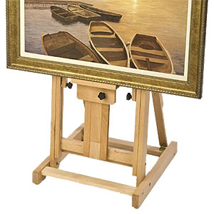 Closeup of a wood floor easel with artist canvas