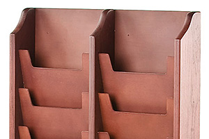 closeup of a wooden magazine wall rack with mahogany stained finish