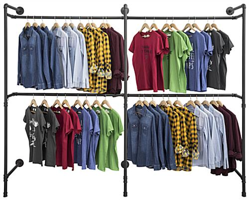 Industrial Wall Display Pipe Rack Showcasing Hanging Shirts