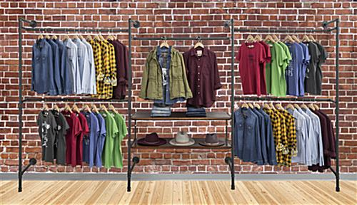 Pipe Outrigger Retail Wall System Showcasing Clothing on Brick Background
