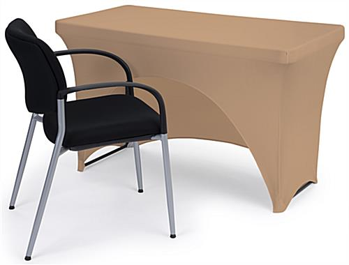 Tan stretch table cloth with open back design