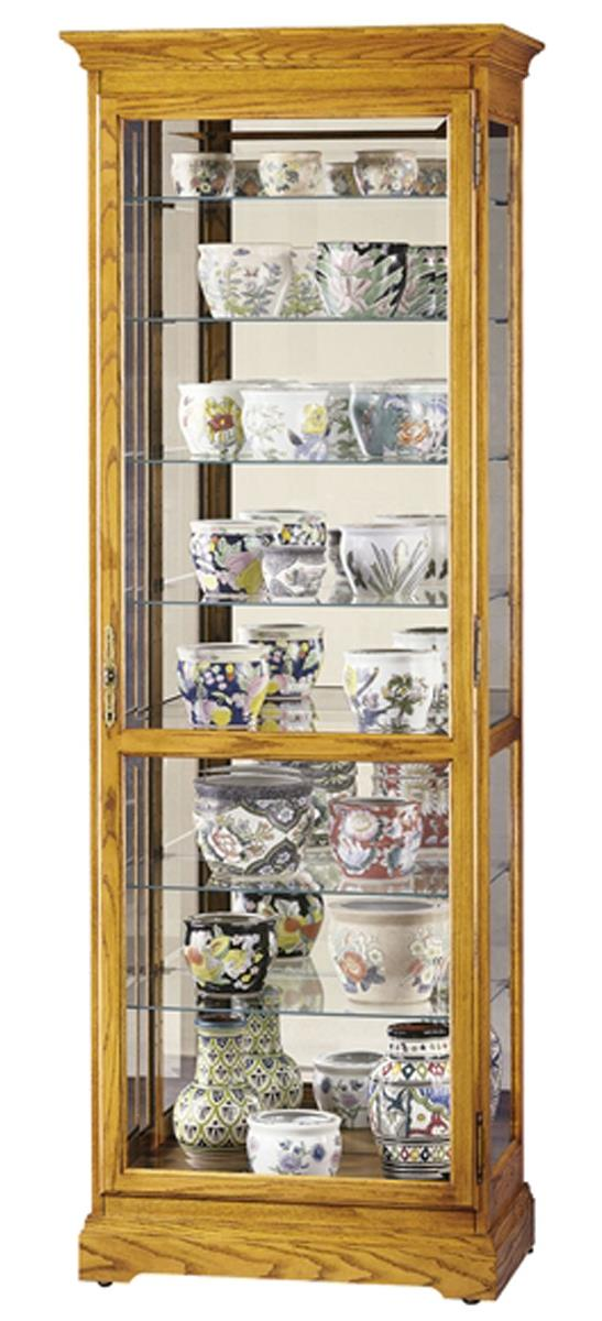 this trophy case for sale is made by howard miller and features a golden oak finish this. Black Bedroom Furniture Sets. Home Design Ideas