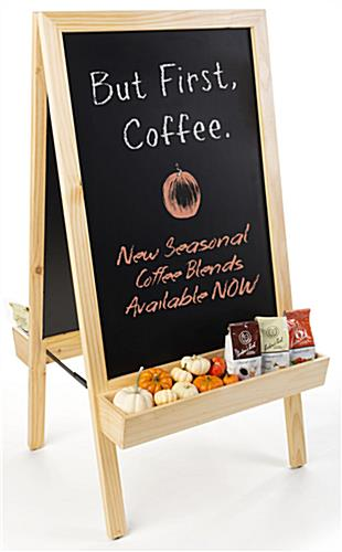 Chalkboard sidewalk sign with planter bottom is constructed of durable wood and metal