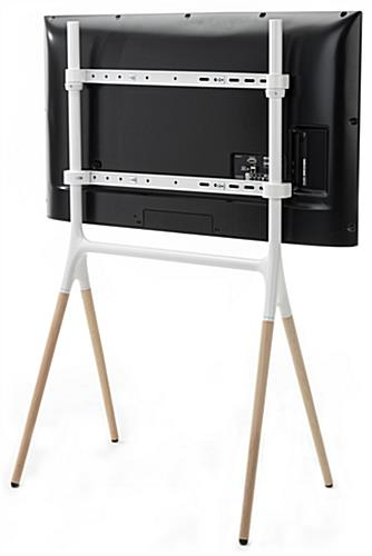 Adjustable mounting brackets included with modern sawhorse-style TV display stand