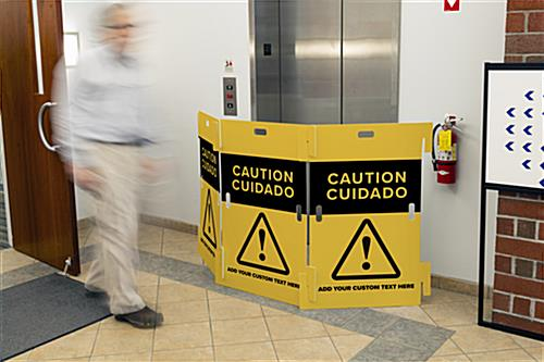 Interlocking caution barricade with overall width of 93 inches when assembled