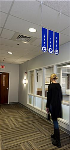 Ceiling hanging directional signage with vivid graphics