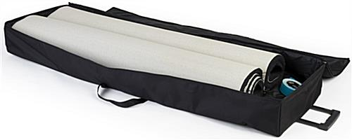 Black rolled trade show booth carpet shown with travel bag