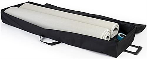 10' x 20' white trade show carpet roll shown with travel bag