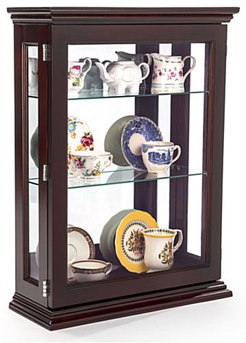 Affordable Espresso Curio Cabinet Propped with Antique Plates and Cups