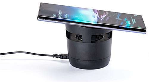 Black wireless charging speaker with non-slip powering platform and base