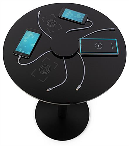 Tables with integrated wireless charging stations allow customers to power devices with ease