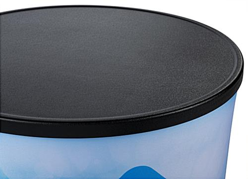 Textured black surface on top of round backlit inflatable counter