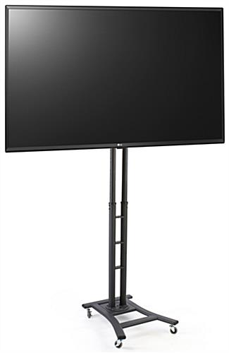 Portable digital signage features four locking casters at rectangular base and 49 inch LG TV