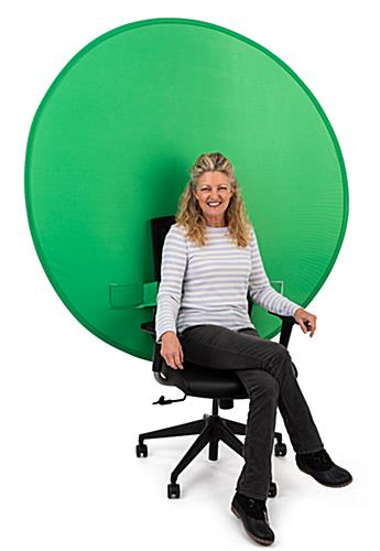 Person Sitting in Chair with Green Screen
