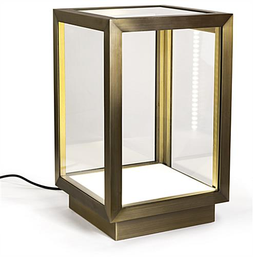 Metal framed square glass curio box includes LED strips on both sides