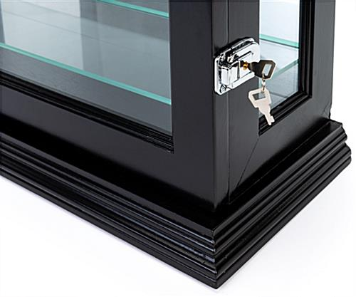 Wall curio cabinet with dual security locks