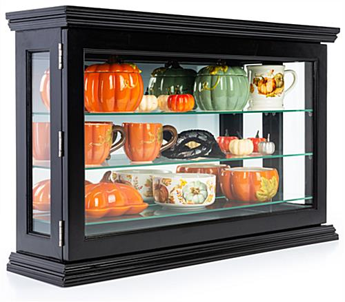 Wall curio cabinet with black finish