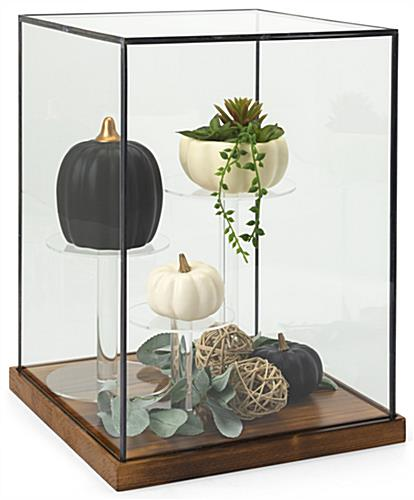 Tall wood and glass countertop display case with black copper edge detail