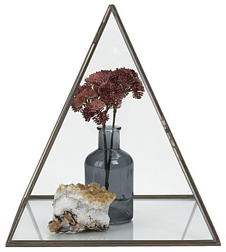 Small glass pyramid box features opening panel with hinged door