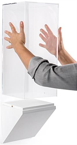 Wedge bottom wall display pedestal is simple to assemble and disassemble