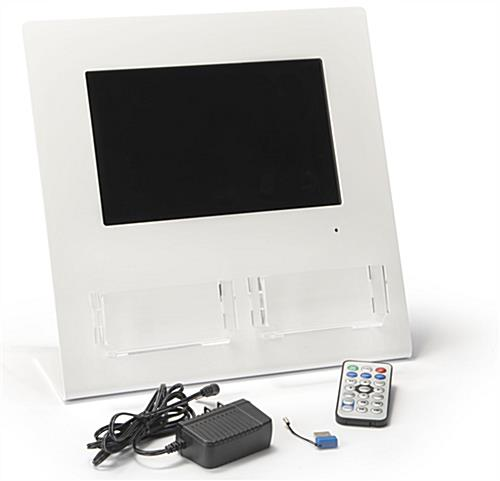 Gift card display with digital screen includes remote