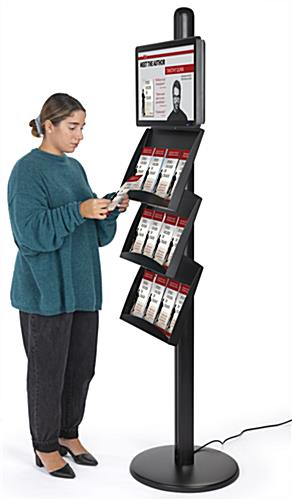 Freestanding literature holder with advertising screen and multi-channel USB interfaces