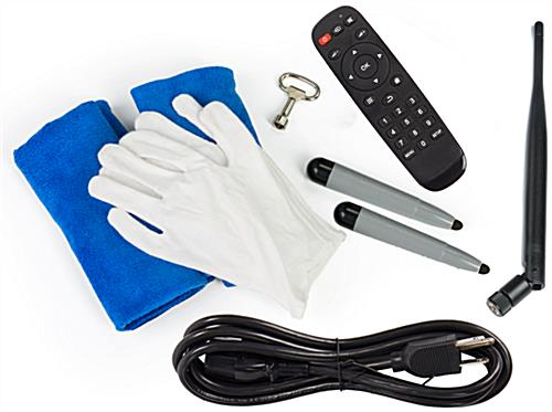 Digital signage display includes cleaning kit and remote control