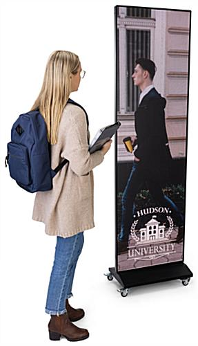 Digital poster screen with overall height of 85 inches when on wheels