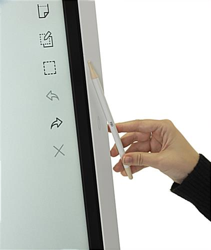 Interactive digital flipchart display with magnetic pen placement