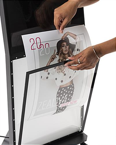 Backlit multimedia kiosk with signage and magnetic cover for illuminated LED panel