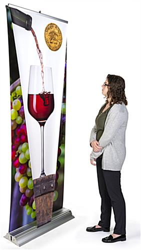 Layered 3D retractable banner stand includes pre-installed graphic panels
