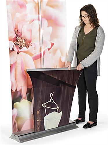 3D layered roll up banner stand easily and conveniently retract into base