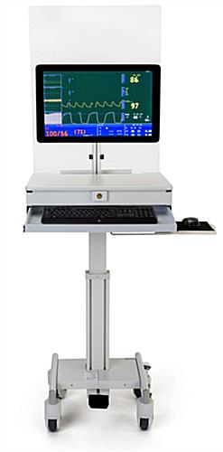 Medical computer workstation with protective barrier and height adjusting foot pedal