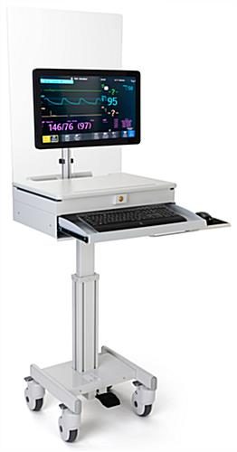 Medical computer workstation with protective barrier for keyboard tray
