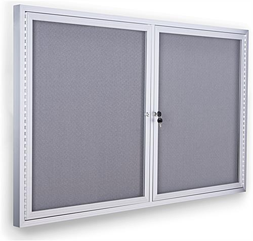 Enclosed polycarbonate bulletin board with silver anodized aluminum frame