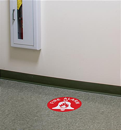 Fire alarm floor safety sign shown in workplace setting