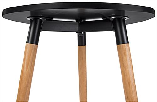 Low triangular side table with black attachment plate