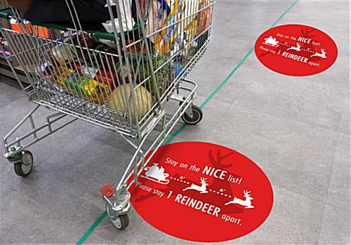 Round social distance floor decal with holiday message with long lasting durability