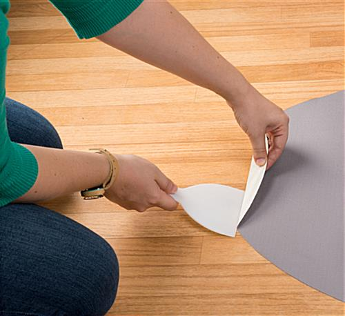 Oval commercial floor sticker with adhesive backing