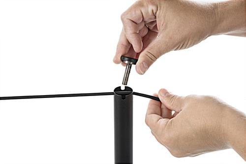 Post Unscrewed to Attach Cord of the 8-Barrier Black Gallery Stanchion System