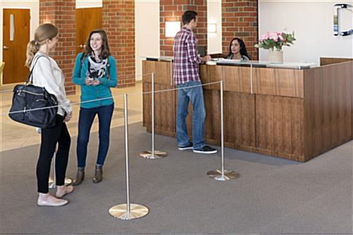 People in Queue Behind the 8-Barrier Silver Gallery Stanchion Set