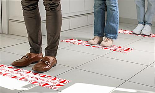 "4"" x 24"" holiday social distancing floor sticker with printed graphic for crowd control"