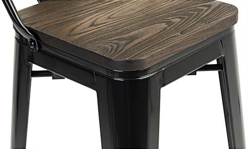 Indoor café table set with black metal and elm wood design accents
