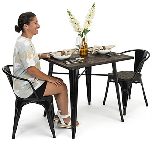 Indoor café table set with black tapered leg design