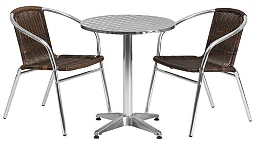 Aluminum restaurant cafe table with dark brown rattan chairs