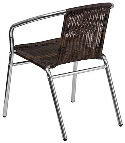 Aluminum rattan restaurant stacking chair in relaxed shape