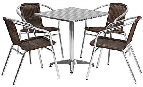 Contemporary aluminum bistro table with dark rattan chairs
