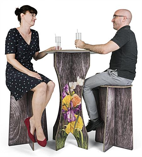 Branded cardboard bar furniture stools comfortably support seated adult