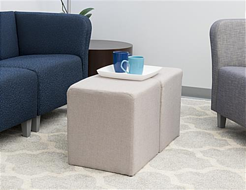 Foam cube ottoman used as coffee table
