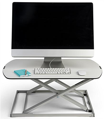 Height adjustable standing desk converter for a more comfortable workday